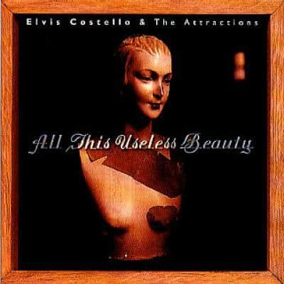 ELVIS COSTELLO - All This Useless Beauty (1996) - Les collaborations discographiques de Paul McCartney : les secrets de l'album (paroles, tablature)